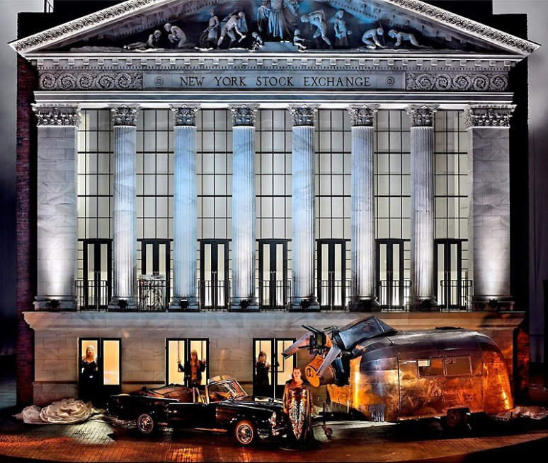 Brünnhilde and the Rhine Maidens in the closing scene of Götterdãmmerung, against a backdrop of the New York Stock Exchange, previously the wrapped Reichstag.
