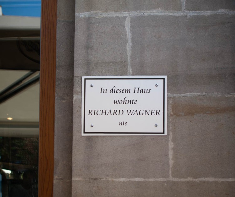 "Reverse-advertising. ""In this house lived Richard Wagner--never."""