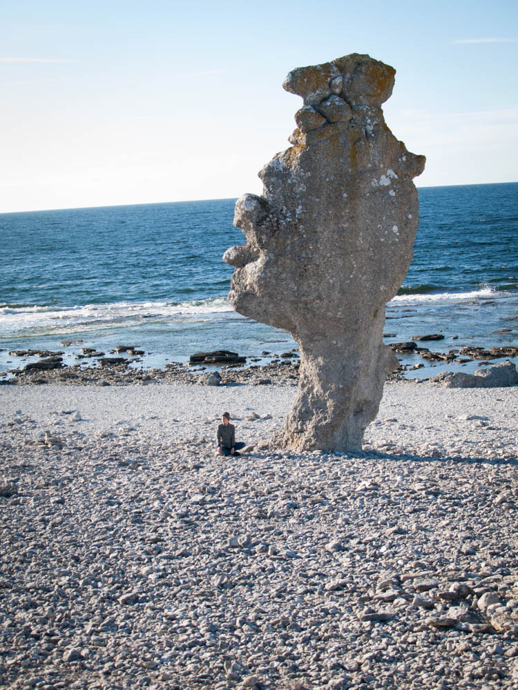 Yoga under a sea stack on Fårö Island.